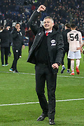 Manchester United interim Manager Ole Gunnar Solskjaer celebrates and gestures to the fans during the Champions League Round of 16 2nd leg match between Paris Saint-Germain and Manchester United at Parc des Princes, Paris, France on 6 March 2019.