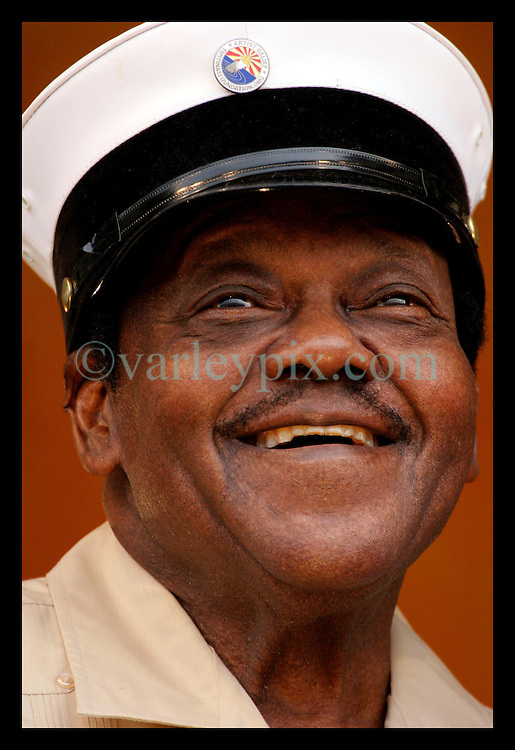 May 7th, 2006. New Orleans, Louisiana. Jazzfest . The New Orleans Jazz and Heritage festival. Legendary musician Fats Domino makes a brief appearance on the Acura Stage after an earlier hospital visit. Fats was supposed to close out Jazzfest, but was taken ill earlier in the day. He appeared briefly to apologise to the crowd that he would be unable to perform due to his ill health.