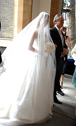 The bride CHLOE DELEVINGNE and her father CHARLES DELEVINGNE at the wedding of Chloe Delevingne to Louis Buckworth at St.Paul's Knightsbridge, London on 7th September 2007.<br />