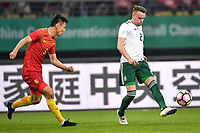 Chris Gunter, right, of Wales national football team kicks the ball to make a pass against Zheng Zheng of Chinese national men's football team in the semi-final match during the 2018 Gree China Cup International Football Championship in Nanning city, south China's Guangxi Zhuang Autonomous Region, 22 March 2018.