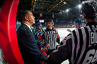 REGINA, SK - MAY 23: Referees speak to Manny Vivieros, head coach of the Swift Current Broncos at the bench during a time out at the Brandt Centre on May 23, 2018 in Regina, Canada. (Photo by Marissa Baecker/CHL Images)