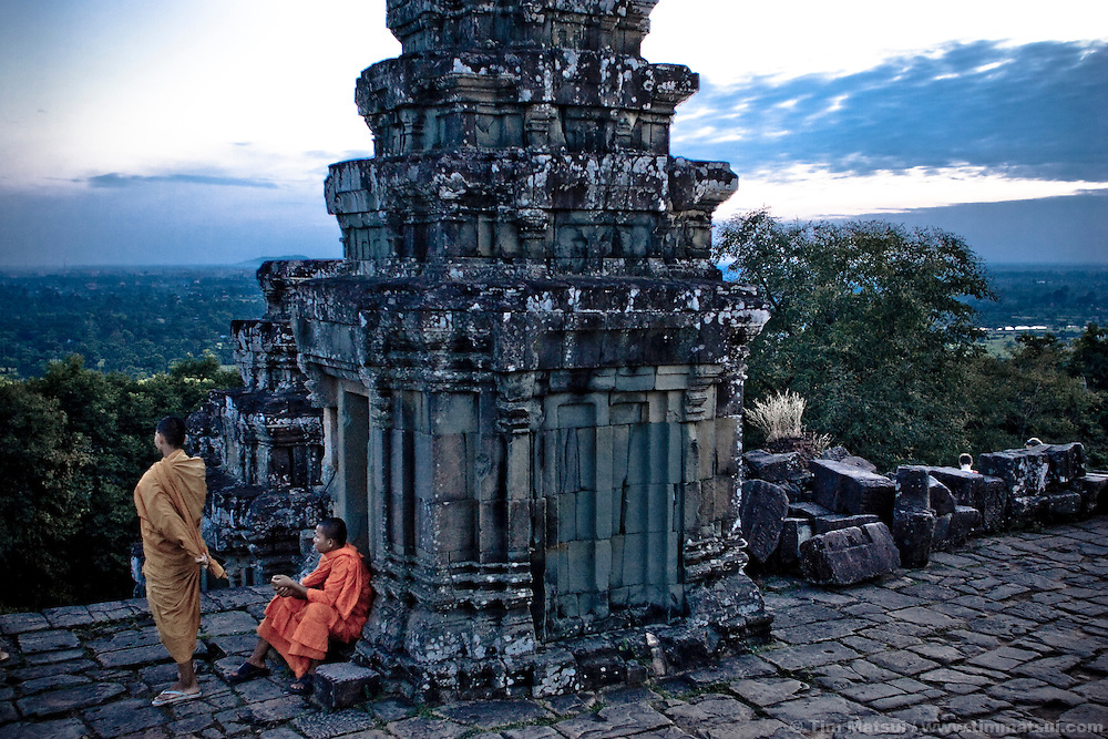 Monks sit atop Phnom Bakheng near Angkor Wat in Siem Reap, Cambodia.
