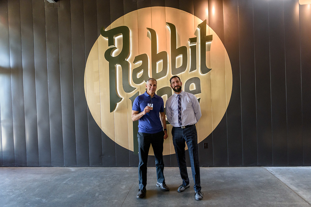 Investors Greg Abbas and Steve Lebder are photographed in front of the logo at Rabbit Hole Distillery, at 711 E. Jefferson Street in NuLu, as they host a ribbon-cutting, grand opening party and a peek inside before opening to the public sometime in June. May 1, 2018
