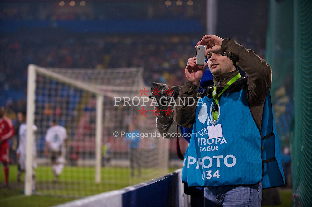 BUCHAREST, ROMANIA - Thursday, February 25, 2010: A photographer during the UEFA Europa League Round of 32 2nd Leg match at the Steaua Stadium. (Photo by David Rawcliffe/Propaganda)