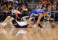 Apr 5, 2013; Phoenix, AZ, USA; Golden State Warriors guard Stephen Curry (30) comes up with the loose ball against Phoenix Suns guard Goran Dragic (1) in the first half at US Airways Center. Mandatory Credit: Jennifer Stewart-USA TODAY Sports