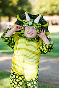 Riley Martin, 3, of Milpitas wears a dinosaur costume during the annual Sunnyhills Neighborhood Association's Sunnyhills Pre-Halloween Party at Albert Augustine Jr. Memorial Park in Milpitas, California, on October 26, 2013. (Stan Olszewski/SOSKIphoto)