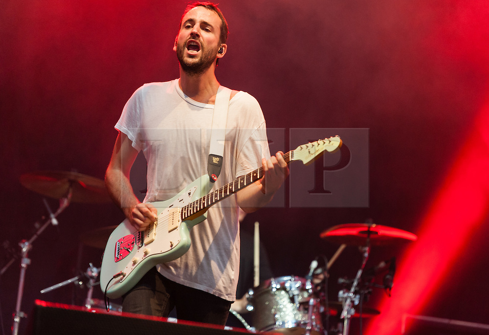 © Licensed to London News Pictures. 29/08/2015. Reading Festival, UK.  Foals performing a surprise set at Reading Festival 2015, Day 2.  In this picture - Jimmy Smith.  Photo credit: Richard Isaac/LNP
