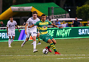 Tampa Bay Rowdies defender Tarek Morad(4) and Swope Park Rangers defender forward Wilson Harris(96) battle for the ball during a USL soccer game, Sunday, May 26, 2019, in St. Petersburg, Fla. The Rowdies defeated the Rangers 1-0. (Brian Villanueva/Image of Sport)