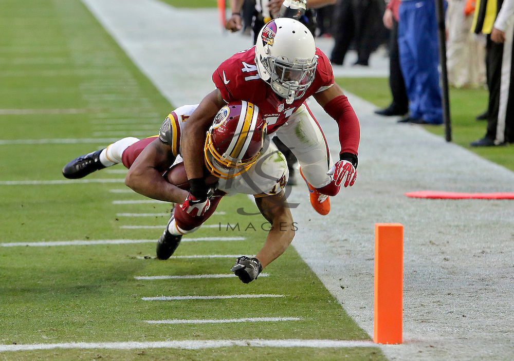 Arizona Cardinals cornerback Marcus Cooper (41) stops Washington Redskins wide receiver Ryan Grant (14) short of the goal line during the first half of an NFL football game, Sunday, Dec. 4, 2016, in Glendale, Ariz. (AP Photo/Rick Scuteri)