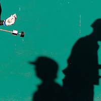 Late afternoon sunlight creates dramatic shadows at San Jose Municipal Stadium on May 22 as Monte Vista Christian's Andy and Austin Muller get in their warmup swings prior to the Mustangs' Central Coast Section semi-finals. MVC lost the game to the Menlo School 8-2.<br />Photo by Shmuel Thaler/Santa Cruz Sentinel