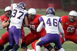 06 December 2014:  Normal Illinois.  Rocco Ammons, Cameron Lee and Ryan Gelber work the line agains. Max Busher and Jake Farley during a 1st round FCS NCAA football game between the Panthers of Northern Iowa and the Redbirds of Illinois State in Hancock Stadium.  Illinois State won the game 41-21.