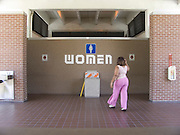 woman going to the toilet at a rest stop facility USA.
