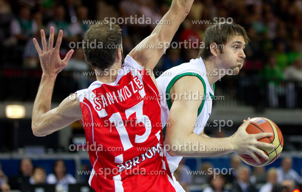 Viktor Sanikidze of Georgia vs Erazem Lorbek of Slovenia during basketball match between National teams of Slovenia and Georgia in Group D of Preliminary Round of Eurobasket Lithuania 2011, on September 3, 2011, in Arena Svyturio, Klaipeda, Lithuania. (Photo by Vid Ponikvar / Sportida)