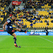 Lima Sopoaga kicks during the super rugby union  game between Hurricanes  and Highlanders, played at Westpac Stadium, Wellington, New Zealand on 24 March 2018.  Hurricanes won 29-12.