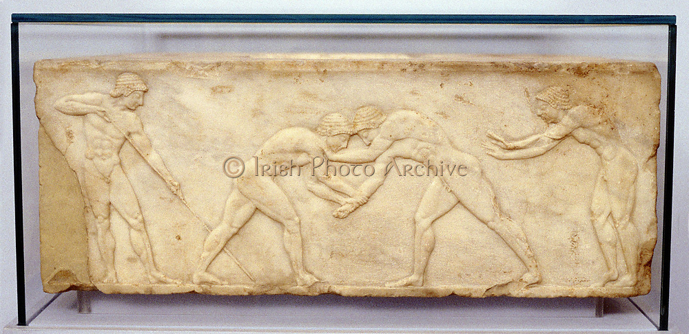 Wrestlers. Fragment of bas-relief frieze c.500 BC.  The Panathenaia, a state religious festival dedicated to Athena, was held every 4 years and included Drama, Music and Athletics. Atheltic element formed Panathenaic Games, precursor of Olympic Games.  Archaeological Museum of Thessaloniki