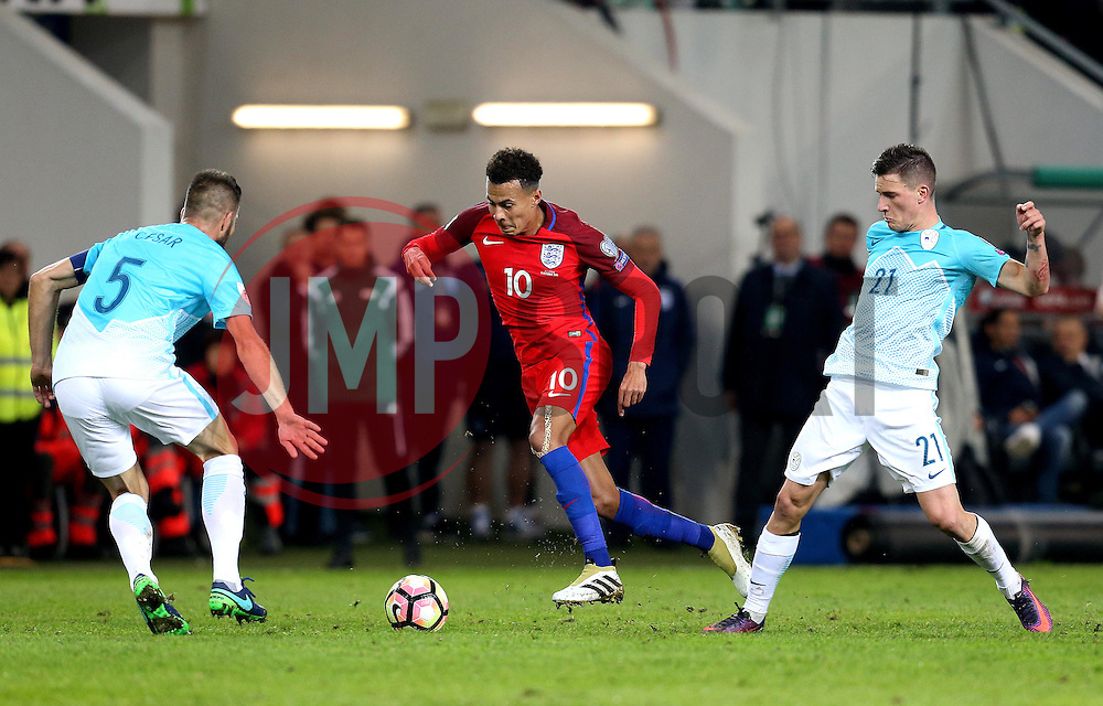 Dele Alli of England takes on the Slovenia defence - Mandatory by-line: Robbie Stephenson/JMP - 11/10/2016 - FOOTBALL - RSC Stozice - Ljubljana, England - Slovenia v England - World Cup European Qualifier