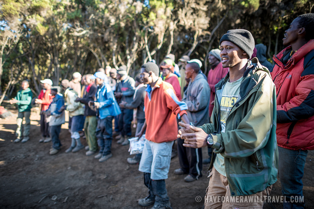 "Porters perform a song and dance as a farewell to their group of hikers at Mweka Camp on Mt Kilimanjaro. The ""Kilimanjaro Song"" is a standard."