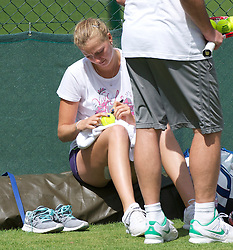 LONDON, ENGLAND - Friday, July 1, 2011: Petra Kvitova (CZE) signs a ball for a fan as she practices ahead of her first Grand Slam Final match on day eleven of the Wimbledon Lawn Tennis Championships at the All England Lawn Tennis and Croquet Club. (Pic by David Rawcliffe/Propaganda)