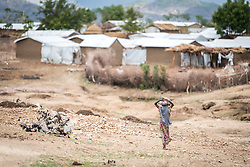 30 May 2019, Mokolo, Cameroon: A girl walks back towards her home in the Minawao camp for Nigerian refugees. The Minawao camp for Nigerian refugees, located in the Far North region of Cameroon, hosts some 58,000 refugees from North East Nigeria. The refugees are supported by the Lutheran World Federation, together with a range of partners.