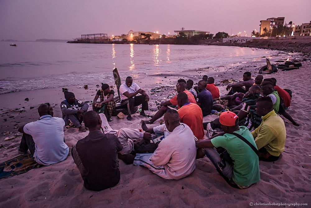The ex-Wrestler Boy Kaire lectures young men at his school at the Corniche in Dakar on April 3, 2015.