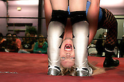 "(030506 -Somerville, MA)  Amanda Buckland, ""Synndy"" 21, of Rochester, NY, gets her hair and head stepped on by ""Alexa Thatcher"" during a World Women's Wrestling event at the Good Time Emporium."