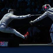 Byungchul Choi, Korea, (left) in action against Erwan Le Pechoux, France, in the Men's Foil Individual event during the Fencing competition at ExCel South Hall during the London 2012 Olympic games. London, UK. 31st July 2012. Photo Tim Clayton