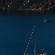 Sailboat against sunrise. Los Cabos, BCS, Mexico