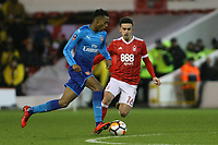 Arsenal's Joe Willock (L) dispossesses Zach Clough of the ball  during The Emirates FA Cup Third Round match between Nottingham Forest and Arsenal at City Ground on January 7, 2018 in Nottingham, England.