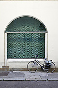 old style bicycle by large window