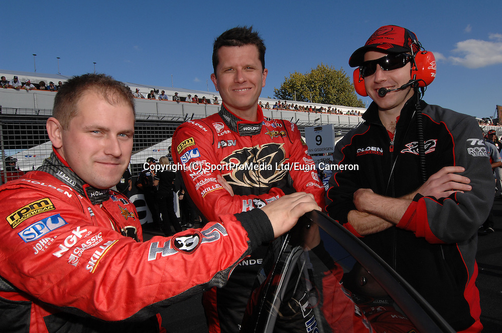 Garth Tander from Melbourne, with his Engineers on the grid prior to Race 1, on Saturday 21th April at the ITM 400 at Hamilton.