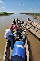 Volunteer team loading a canoe, near San Lorenzo de Moxos, Beni, Bolivia