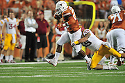 AUSTIN, TX - OCTOBER 18:  Malcolm Brown #28 of the Texas Longhorns is wrapped up by Jevohn Miller #55 of the Iowa State Cyclones on October 18, 2014 at Darrell K Royal-Texas Memorial Stadium in Austin, Texas.  (Photo by Cooper Neill/Getty Images) *** Local Caption *** Malcolm Brown; Jevohn Miller