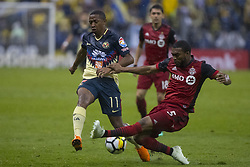April 9, 2018 - Mexico City, MEXICO CITY, Mexico - Andres Ibarguen of Club America struggles for the ball with Ashtone Morgan of Toronto FC during 2018 CONCACAF Champions League Semifinals, Leg 2 match between Club America and Toronto FC at Azteca Stadium in Mexico City, Mexico on 10 April, 2018. (Credit Image: © Ernesto Perez/NurPhoto via ZUMA Press)