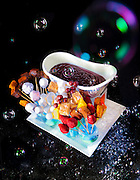 "A truly incredible dessert called ""Chocolate G-Cuzzi"" created by Barton G. Weiss at Barton G The Restaurant in Miami Beach. it features melted dark chocolate fondue with ice cream bites, fresh fruit, and assorted dippables; and is served in a mini-bathtub with spectacular bubble-bath bubbles flying out of a bubble-blowing machine hidden beneath the tub!"