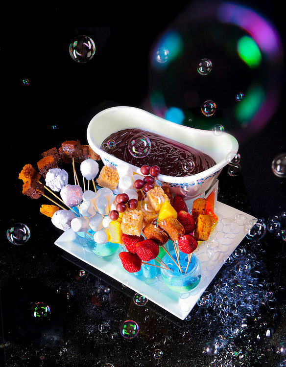 """A truly incredible dessert called """"Chocolate G-Cuzzi"""" created by Barton G. Weiss at Barton G The Restaurant in Miami Beach. it features melted dark chocolate fondue with ice cream bites, fresh fruit, and assorted dippables; and is served in a mini-bathtub with spectacular bubble-bath bubbles flying out of a bubble-blowing machine hidden beneath the tub!"""
