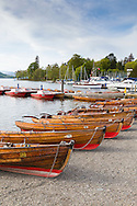 Rowing boats chained together on the edge of Windermere on a May evening