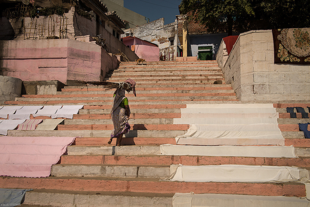 — Along the banks of the Ganga (Ganges) River, steep steps lead back to the alleyways of the old city. The riverfront is a parade of people, doing their chores, bathing or performing religious rituals.