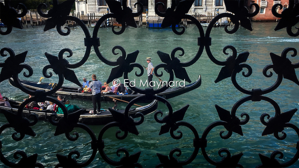 Gondolier seen from the Peggy Guggenheim Museum Venice, Italy.<br />