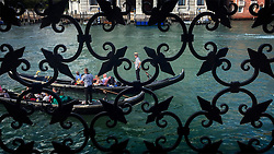 Gondolier seen from the Peggy Guggenheim Museum Venice, Italy.<br /> (iPhone image)<br /> Photo: Ed Maynard<br /> 07976 239803<br /> www.edmaynard.com