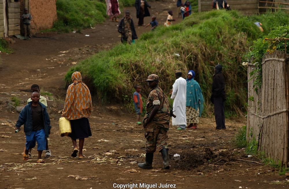Karuba, Congo-Rebels loyal to warlord Laurent Nkunda mingle with civilians in this newly-seized town. The rebels have been accused of forcibly recruiting boys as young as 12.