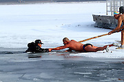 CHANGCHUN, CHINA - DECEMBER 10: China Out - Finland out<br /> <br /> Winter Swimmers Rescue Man From A Hole In The Ice<br /> <br /> An elderly man is saved by several winter swimming lovers after slipping on the ice and falling into a hole at Nanhu Park on December 10, 2013 in Changchun, Jilin Province of China. <br /> ©Exclusivepix
