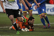 James Shea can only look on as Adam Buxton pulls away during the Sky Bet League 2 match between AFC Wimbledon and Accrington Stanley at the Cherry Red Records Stadium, Kingston, England on 24 January 2015. Photo by Stuart Butcher.