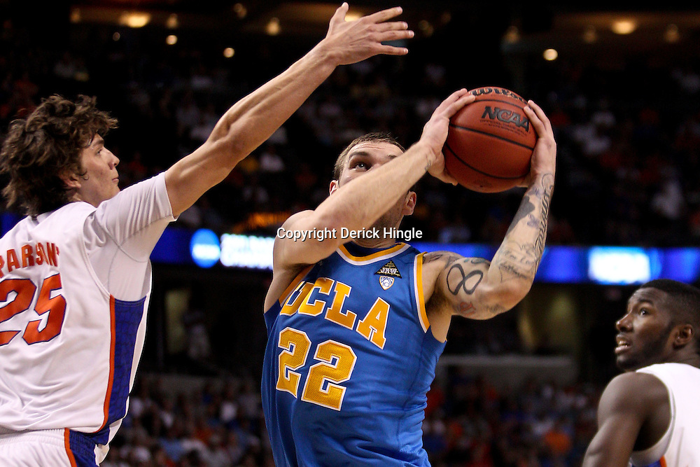 Mar 19, 2011; Tampa, FL, USA; UCLA Bruins forward Reeves Nelson (22) shoots over Florida Gators forward Chandler Parsons (25) during second half of the third round of the 2011 NCAA men's basketball tournament at the St. Pete Times Forum. Florida defeated UCLA 73-65.  Mandatory Credit: Derick E. Hingle