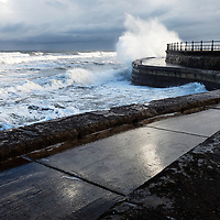 Waves Crashing over the Sea Wall at High Tide in South Bay at Scarborough North Yorkshire England