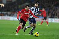 Cardiff city's Gary Medel breaks away from WBA's Claudio Yacob. Barclays Premier league, Cardiff city v West Bromwich Albion at the Cardiff city Stadium in Cardiff, South Wales on Saturday 14th Dec 2013. pic by Andrew Orchard, Andrew Orchard sports photography.
