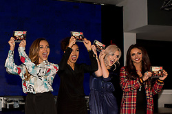 © Licensed to London News Pictures. 11/11/2013. London, UK. British girl band Little Mix hold a signing for their new album release. The band, who won the eighth X Factor series attended HMV in Oxford Street to meet their fans and sign copies of the album, Salute. Photo credit : Simon Ford/LNP