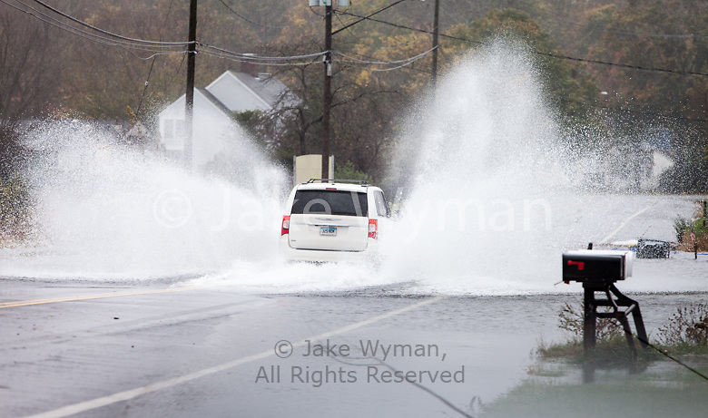 A van driving through a flooded section of Route 1 in Madison Connecticut during the height of Hurricane Sandy.