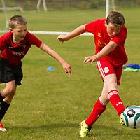 Joseph Flanagan shoots for goal at the FAI Eflow Summer Soccer School in Lisdoonvarna