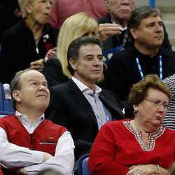 Apr 9, 2013; New Orleans, LA, USA; Louisville Cardinals men's basketball coach Rick Pitino (center) looks on during the first half of the championship game in the 2013 NCAA womens Final Four against the Connecticut Huskies at the New Orleans Arena. Mandatory Credit: Derick E. Hingle-USA TODAY Sports