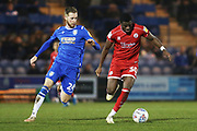 Beryly Lubala and Ben Stevenson in action during the EFL Sky Bet League 2 match between Colchester United and Crawley Town at the JobServe Community Stadium, Colchester, England on 1 January 2020.